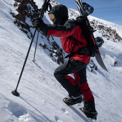 Jeremy Jones wearing the Shralpinist 3L Gore-Tex Pro pant in safety red.